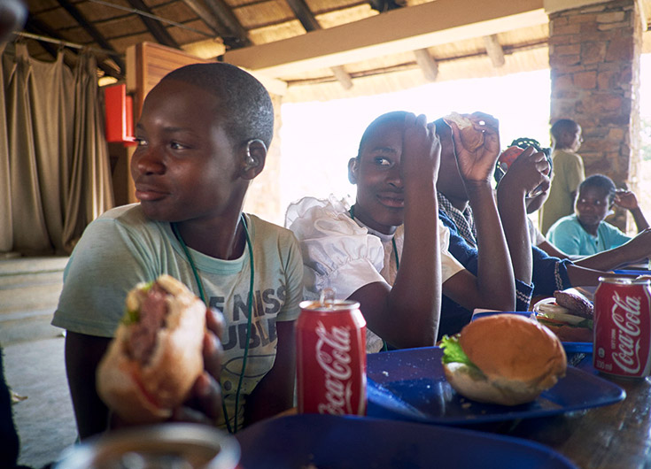 What teenager doesn't enjoy a burger and a coke? Our workshop participants look very happy.